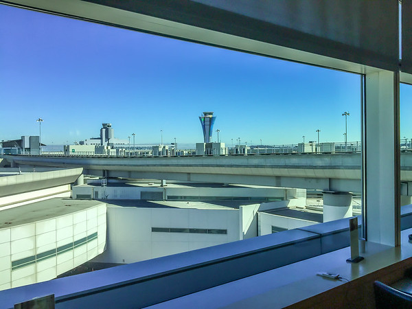 I had a free pass to the United Airlines International Club at SFO, so I headed there for a bit prior to going on to the gate.  The new SFO Control Towers (non-operationsl at the moment; under construction) is the tallest structure in the distance.  The existing control towers is to the left.