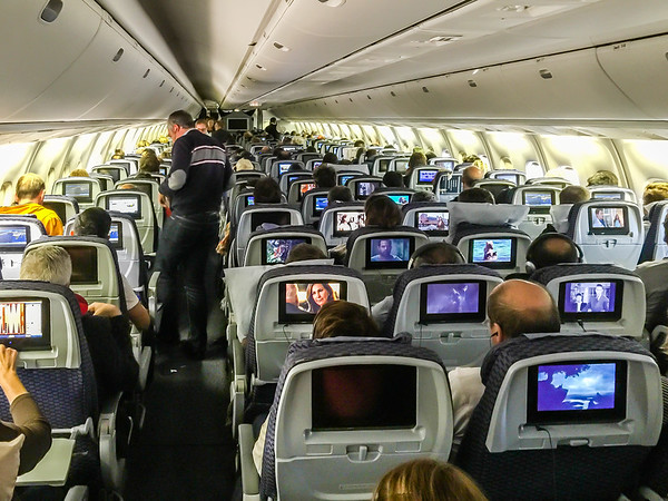 After about 10 hours in the air, we are over Ireland......early morning on October 3rd.....headed toward Paris.  I just made a potty stop and am headed back to my seat almost all the way down this aisle.